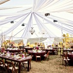 Wedding tent with wooden chairss