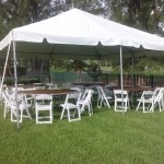 wedding tent with tables and chairs