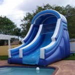 big blue water slide with no pool