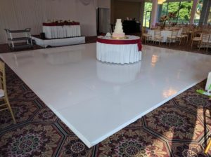 white vinyl dance floor for wedding rentals